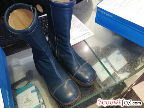 Unique and special, these funky blue boots are worthy of repair.